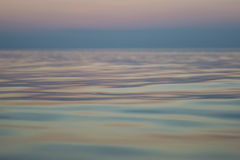 Calm sea during sunset. Macro shooting of calm sea during sunset Stock Photo