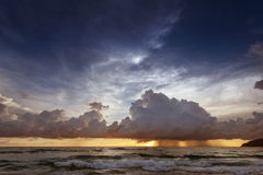 Calm sea on the sunset sky background blue. Calm sea on the sunset cloudy sky background Stock Photos