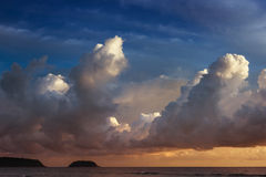 Calm sea on the sunset sky background blue. Calm sea on the sunset cloudy sky background Stock Photo