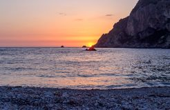 A calm sea at sunset time. Seascape. View of the sea and rocks at sunset Greece, Corfu Island Royalty Free Stock Photo