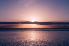 Calm Sea Under Blue Sky during Sunset Stock Image