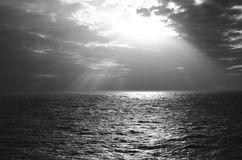 Calm Sea Under Sun in Grayscale Photography Stock Photo