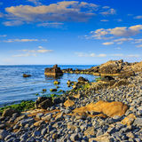 Calm sea wave on rocky shore Stock Images