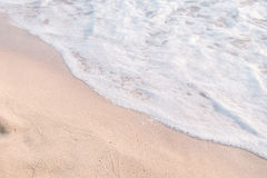 Calm sea wave. With white foam on the beach royalty free stock images