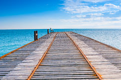 Calm sea and wooden pier Royalty Free Stock Photos