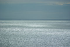 Calm seas. Silver light falling on calm sea just after sun set royalty free stock images
