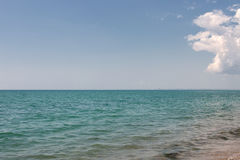 Calm seascape. Clear sky with one cloud and a horizon line Royalty Free Stock Photos