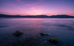 Calm seascape at sunset. Calm seascape with beacon and rocks Stock Image