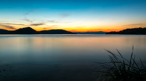 Calm seascape at sunset. Calm seascape with grass at sunset Stock Images