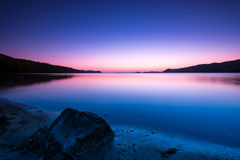 Calm seascape at sunset. Tranquil sunset sea and rocks Royalty Free Stock Photos