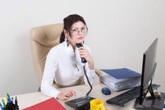 Calm secretary with handset Royalty Free Stock Photos