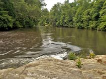 Lazy Dan River. A calm section of the Dan River near Danbury, North Carolina. The Dan is a popular spot for kayaking and canoeing royalty free stock photography
