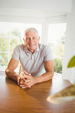 Calm senior man sitting in living room Stock Images