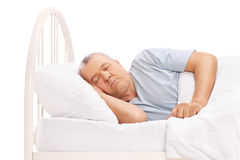 Calm senior man sleeping in a bed Royalty Free Stock Photography