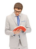 Calm and serious man with book Royalty Free Stock Image