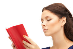 Calm and serious woman with book Stock Photo