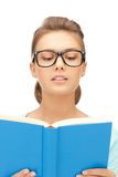 Calm and serious woman with book stock image