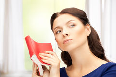 Calm and serious woman with book Stock Photography