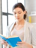 Calm and serious woman with book Royalty Free Stock Images