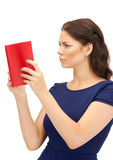 Calm and serious woman with book Royalty Free Stock Photos