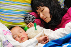 Calm sleep. Mother and son fell asleep, and is so calm Stock Photography