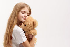 Calm small female kid keeping toy Royalty Free Stock Images