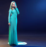Calm and smart lady in evening gown Royalty Free Stock Photos
