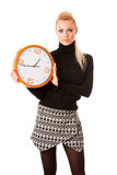 Calm smiling woman with big orange clock gesturing no rush, enough time to be punctual. stock photos