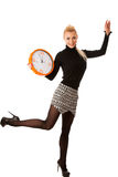 Calm smiling woman with big orange clock gesturing no rush, enough time to be punctual. royalty free stock photography