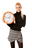 Calm smiling woman with big orange clock gesturing no rush, enou Stock Photography