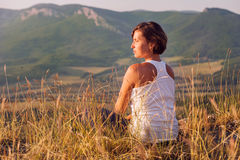 Calm smiling woman enjoyed with gently shining sun Royalty Free Stock Photo