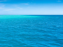 Calm South Pacific Ocean. Rich blue and aqua seas, with a heat hazo on the horizon and an azure colored sky. Fiji Islands, South Pacific Big copy space royalty free stock photography