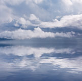 Calm after Storm. Rain clouds over a calm Pacific ocean Royalty Free Stock Photo