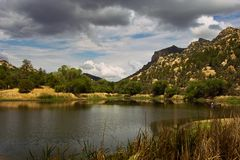 The Calm Before The Storm. Taken at a small lake in Arizona as a storm rolls in Royalty Free Stock Photo