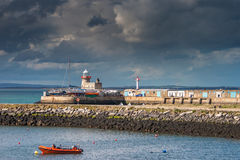 Landscape of Howth lighthouse before the storm, Dublin, Ireland. Sunset over the lighthouse in Howth, county Dublin Royalty Free Stock Photo