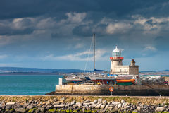Calm before the storm at Howth lighthouse, Ireland. Sunset over the lighthouse in Howth, county Dublin Stock Image