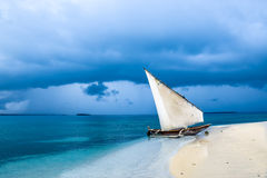 The calm before the storm. Lonely sail boat on a beach in Tanzania Royalty Free Stock Image