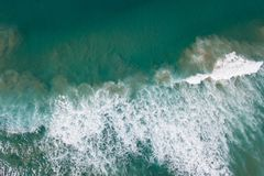 Calm Before the Storm. Looking straight down over a wave breaking off Lake Cathie beach NSW, Australia Royalty Free Stock Photo
