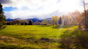 Calm before the storm. View of a meadow in late evening as a storm comes over the mountains in Victor Montana Royalty Free Stock Photo