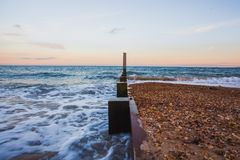 Calm and stunning sunset. A sunset over the English Channel. Gentle waves and a cool breeze for a perfect evening Stock Photos