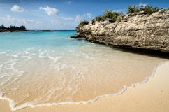 Calm sunny beach. Wide angle calm beach with gentle wave sweeping onto sand Royalty Free Stock Photography