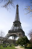 Calm sunny eiffel tower view. In a park, with people having fun Royalty Free Stock Photography