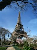 Calm sunny eiffel tower view - France. Calm sunny eiffel tower view, with garden close too, walkroad stock photos