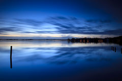 Calm sunrise over a lake with clouds stock photography
