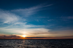 Calm sunset and clouds over lake Royalty Free Stock Photo
