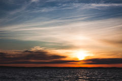 Calm sunset and clouds over lake Royalty Free Stock Photography