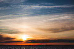 Calm sunset and clouds over lake Stock Photography