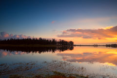 Calm sunset over lake surface Stock Photography