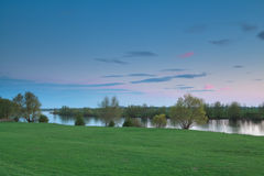Calm sunset over river Ijssel Stock Images