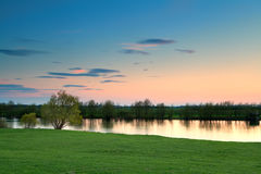 Calm sunset over river Ijssel, Netherlands Royalty Free Stock Photos